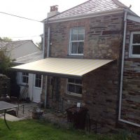cream awning fitted to a period home