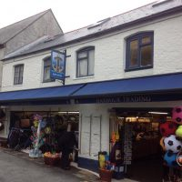 blue awning on shop in the high street