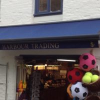 blue awning fitted to a shop front