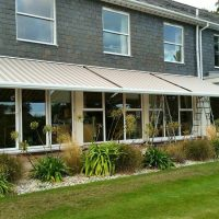 awning fitted to above windows on restaurant