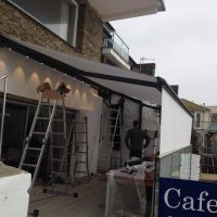 full awning installed on cafe