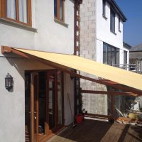 yellow awning fitted to a home