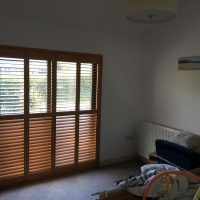 window shutters in wood colour