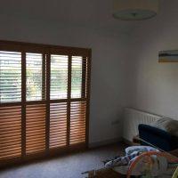 window shutters in wood colour