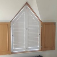 bespoke window shutters fitted to alcove window