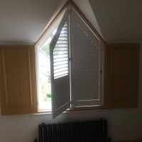 shutters installed onto arched window