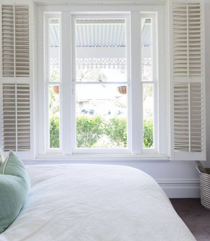 Wooden shutters inside of a bedroom