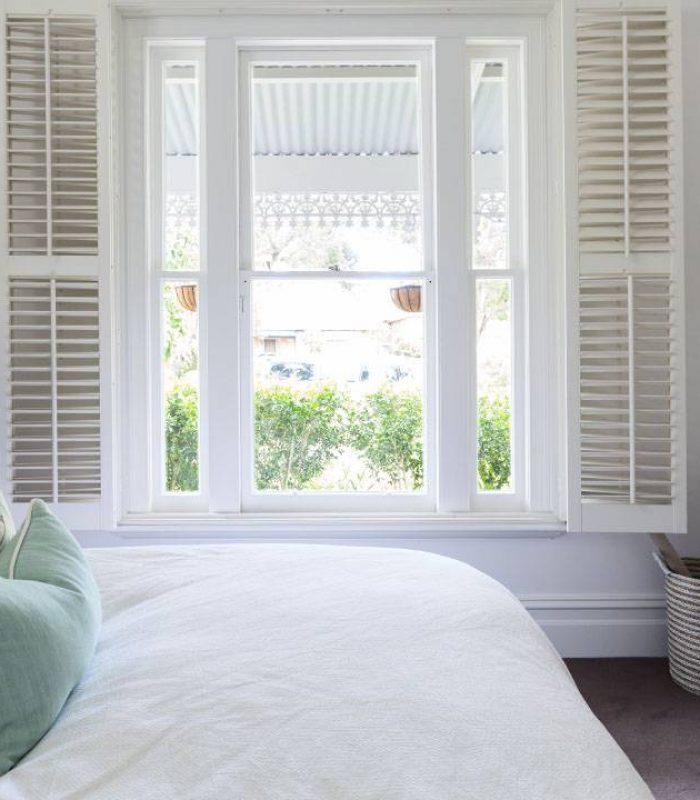 Wooden shutters inside of a bedroom